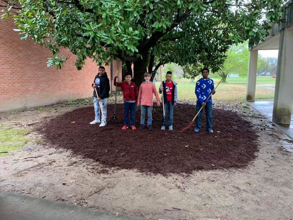 6th Graders help make the grounds beautiful.